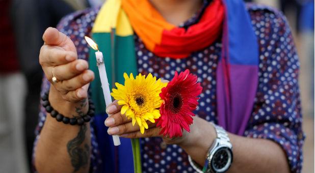 reuters-pulse-vigil-flowers-scarf
