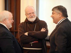 Cardinal SeanO'Malley, center, speaks with President of the AFL-CIO Rochard Trumka, right, during the Erroneous Autonomy conference in Washington, D.C, on Jan. 10, 2017. Photo courtesy of The Catholic University of America/Dana Rene Bowler.